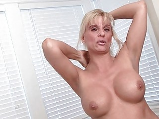 classy blonde milf strips and pokes her prostitute