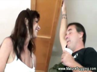 bigbreasted milf rubs a boys dick