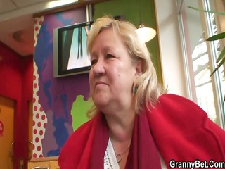 large grandma is picked up inside cafe