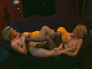 two busty blond woman in stockings with a foot
