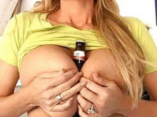 albino older babe enjoying with bottle of bear