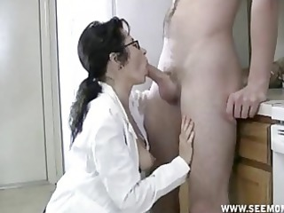 grown-up girl with glasses obtains oral full of