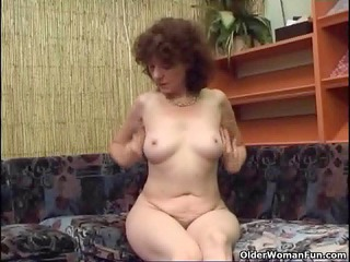 hirsute granny plays with a vibrator