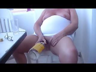 bbw granny masturbates with a bottle