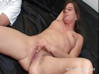 red-haired cougar riding phallus