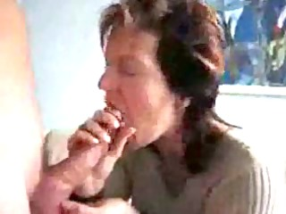 older lady tasting & swallowing spill