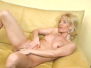 grownup blond masturbates with herself