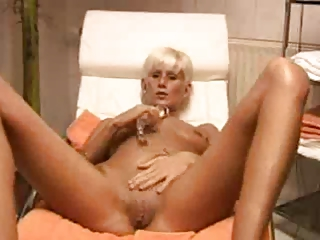 blonde milf plays