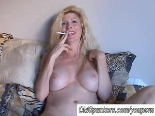 sexy pale cougar babe enjoys a smoke break