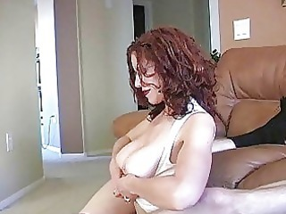 masturbating redhaired mature babe with glasses