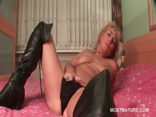 grownup blond tramp wipes her juicy vagina inside