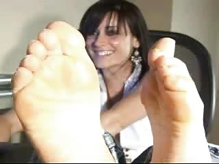 woman uncovering feet on webcam