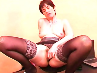 older dame with short hair in black pantyhose