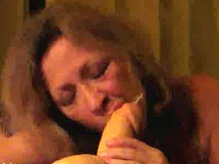 busty older woman licks a shooting plastic cock