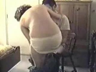 mature couple fucking on a chair