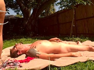 lady sunbathes while gangbanging