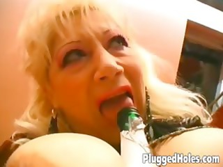 busty babe drives a bottle like slutty