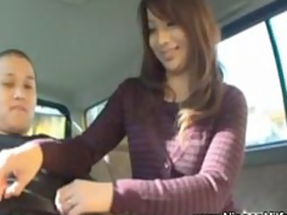 japanese belle gives handjob on backseat of car
