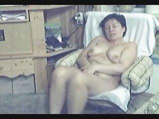 my mum home alone. hidden cam into livingroom