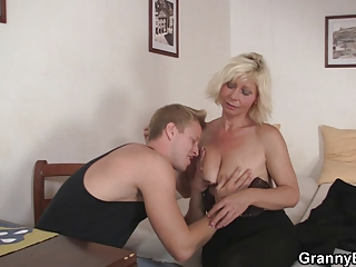 mature blonde gets it from behind