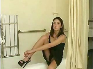 woman getting nude inside the bathroom