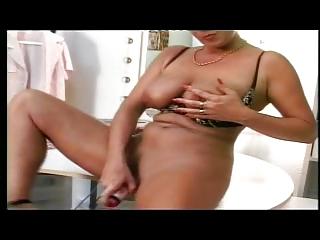 shorthaired german woman pushing dildo