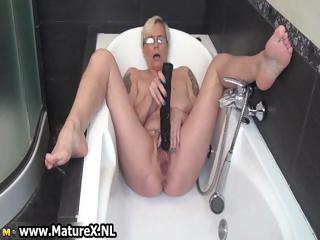 horny grown-up babe piercing her own taut part6