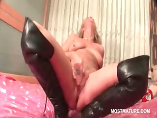mature in leather galoshes doing herself in bunk