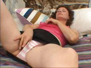 mature brunette with floppy bossom is rubbing her