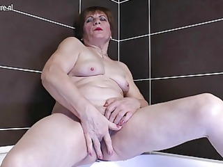 young grandma pushing plastic cock in the bathroom