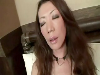 asian woman uses a plastic libido on her shaggy