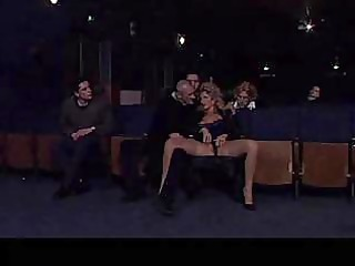 busty lady gives head into a cinema hall