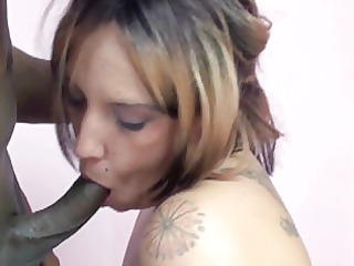 tattooed girl lexxi licking a strong brown penis