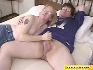 older blonde licking on a small dick