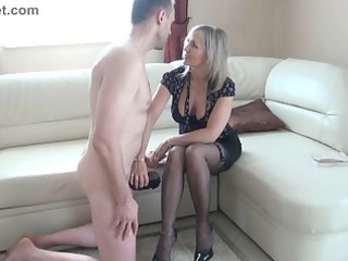 slut cougar makes a wank with the feet